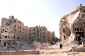 People walk past a row of destroyed buildings near the Al-Hayat Hospital in the northern Syrian city of Aleppo on September 10. Syrian troops on Tuesday pounded Aleppo to thwart a rebel advance in Syria's second city, activists said, as Hollywood star Angelina Jolie visited a Jordanian camp for refugees from the conflict. AFP Photo