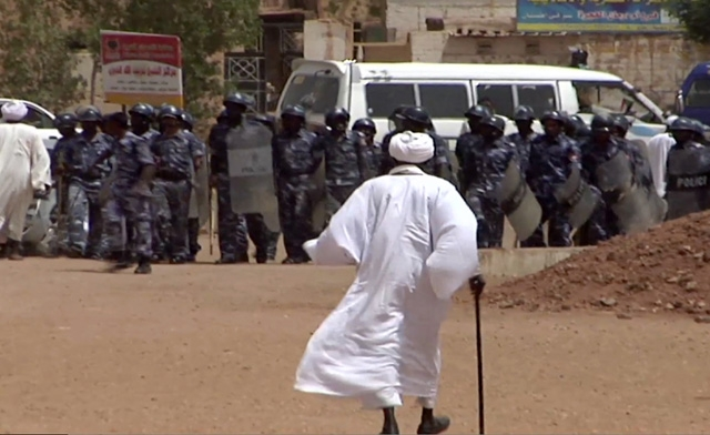 Sudanese riot police stand guard in Khartoum (AFP/file)