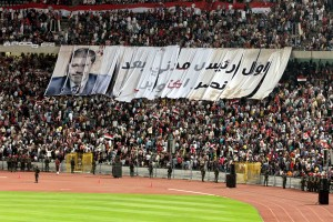 Crowds fill Cairo stadium to witness President Morsy's speech on the anniversary of the 6 October War. The banner reads 'First civilian president after October's victory' Mohamed Omar