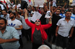 A female protester shouts during Friday's demonstrations. (Photo by Hassan Ibrahim)