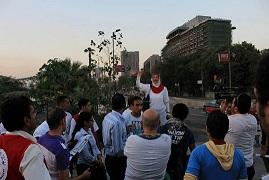 "A member of the ""Be a man"" campaign talks on the streets of Cairo during a previous anti-sexual harassment event. (File photo, Isstargel group)"