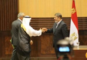 President Morsy greets a Sinai sheikh during his visit to Al-Arish Nasser Elazazy