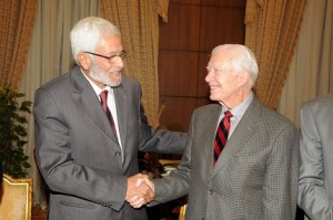 Jimmy Carter shakes hands with constituent assembly head Hossam El-Gheriany at the Shura Council. (PHOTO BY MOHAMED OMAR)