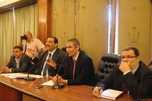 Former MP Mohamed El-Omda, left, speaks alongside colleagues in the Parliament building Mohamed Omar