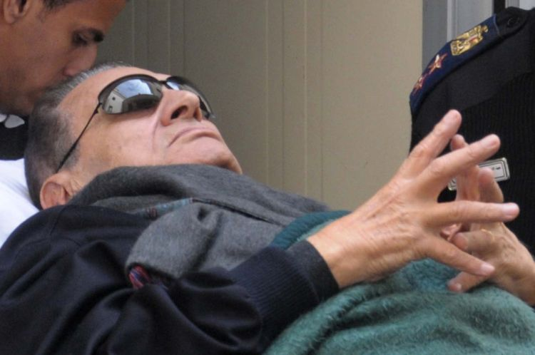 Former president Hosni Mubarak lies on a stretcher as he leaves court (File photo) AFP PHOTO