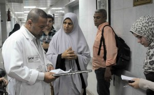 Medical staff speak to patients at a Cairo hospital despite ongoing strike action Mohamed Omar