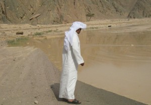Man watches the flood waters near Nuweiba Nasser El-Azazy