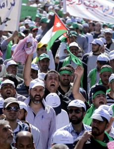 Jordanian protestors take part in a demonstration in Amman AFP PHOTO / KHALIL MAZRAAWI