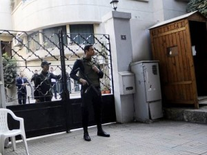Security forces stand outside the offices of one of the NGOs raided in December 2011 (File photo) AFP PHOTO