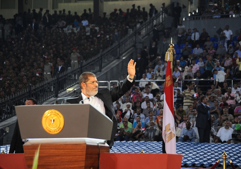 President Mohamed Morsi waves at the crowd as he delivers his speech to the nation in Cairo Stadium, in Cairo, to mark the 39th anniversary of the Yom Kippur war against Israel AFP PHOTO / HO / EGYPTIAN PRESIDENCY