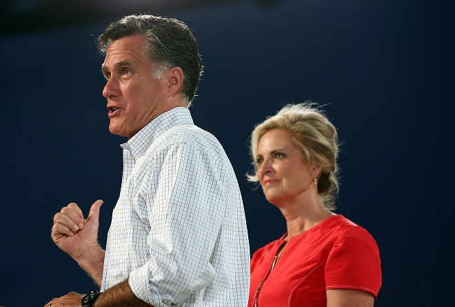Republican presidential candidate, former Massachusetts Gov. Mitt Romney speaks next to his wife Ann Romney during a campaign rally in Apopka, Florida AFP PHOTO / JUSTIN SULLIVAN