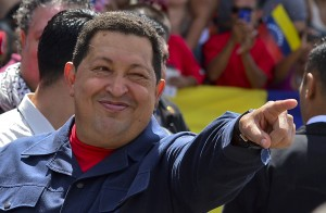 Venezuelan President Hugo Chavez gestures before voting in Caracas AFP PHOTO / LUIS ACOSTA
