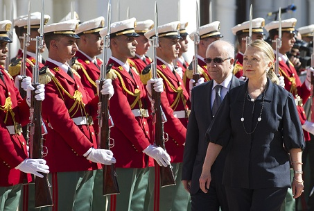 Algerian Foreign Minister Mourad Medelci walks alongside US Secretary of State Hillary Clinton as she arrives for meetings at the Mouradia Palace in Algiers. (AFP PHOTO / SAUL LOEB)
