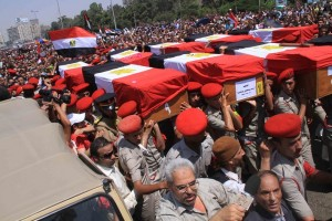 Funeral takes place in Cairo for the soldiers killed by gunmen near the border with Israel at Rafah. After this attack Morsy sacked several head figures in North Sinai and retired Hussein Tantawi, defence minister at the time Mohamed Omar