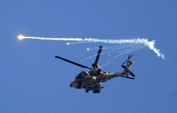 An Israeli helicopter drops flares over the Gaza Strip. (AFP File / Jack Guez)