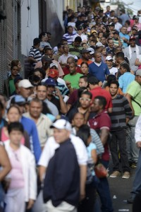 People queue at a polling station in the sprawling Petare slum, Caracas AFP PHOTO / LEO RAMIREZ