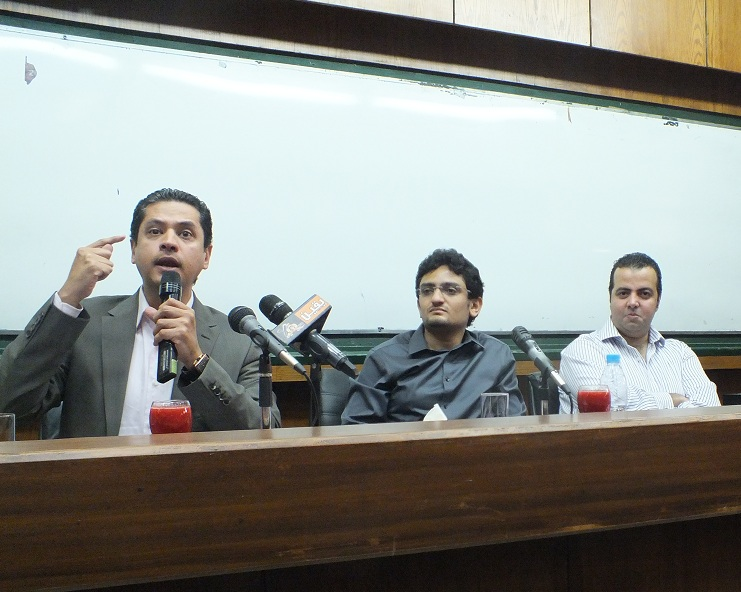 Abdel Rahman Youssef (left), Wael Ghoneim (center) and Mostafa Al-Naggar (right) discuss the political structure of Egypt with the students of Cairo University Fady Salah / DNE