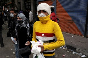 A volunteer provides medical assistance to protesters on Mohammed Mahmoud street in November 2011 Laurence Underhill / DNE