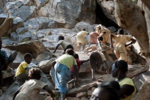 Women and children take shelter in natural caves (File photo) AFP PHOTO / Phil Moore