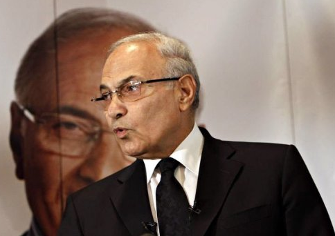 The Prosecutor General Tala'at Abdallah announced on Tuesday that he has asked the Office of International Cooperation to prepare a memorandum asking Interpol to arrest former presidential candidate Ahmed Shafiq. (AFP/File, Mohammed Abed)