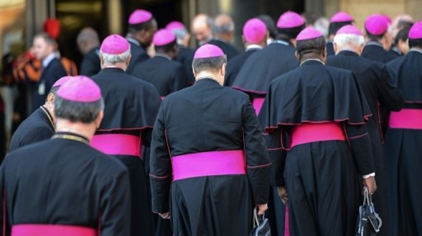 Bishops arrive for a meeting of Roman Catholic Church leaders from around the world at the Vatican on October 8, 2012. (AFP PHOTO)