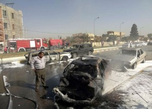 A man looks at destroyed vehicles following two car bombs near the provincial government headquarters in Kirkuk. (AFP/ Marwan Ibrahim)