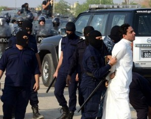 A protester is detained by Kuwaiti riot policemen. (AFP Photo/ Yasser al-Zayyat)