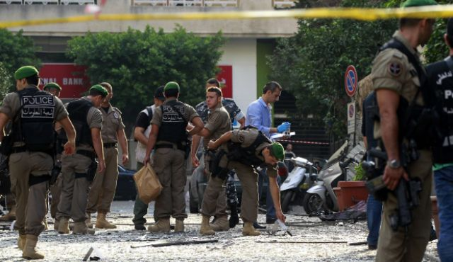 Lebanese security forces inspect damages in Beirut's predominantly Christian district of Ashrafieh on October 20, 2012, a day after a deadly car bomb blast. Photo by AFP