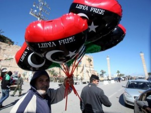 A Libyan holds balloons in the colours of the new national flag in Tripoli. (AFP Photo)