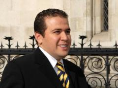 Lotfi Raissi wants Hillary Clinton to help lift a US arrest warrant against him. (AFP FILE/ BERTRAND LANGLOIS)