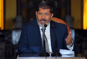 President Morsy thinks of the bank account as a method through which figures of the old regime would find it easier to return stolen funds (AFP PHOTO)