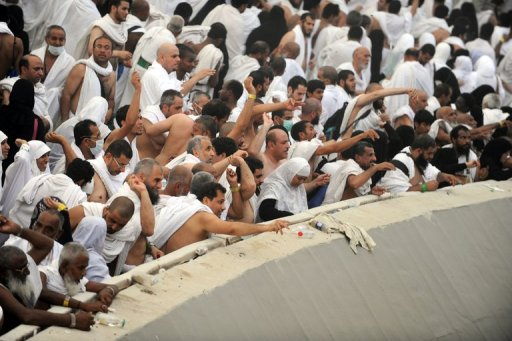 "Muslim pilgrims throw pebbles at pillars during the ""Jamarat"" ritual, the stoning of Satan, in Mina. (AFP PHOTO/ FAYEZ NURELDINE)"