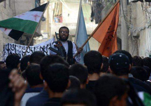 A rebel commander addresses demonstrators in Aleppo (AFP/File, Tauseef Mustafa)