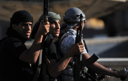 UN accused rebels of possible war crimes over a video showing soldiers being executed. (AFP, Bulent Kilic)