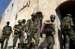 Syrian government forces patrol in the northern Syrian city of Aleppo on October 7, 2012. Aleppo was shaken by the heaviest fighting of an almost three-month offensive against rebels in Syria's second city, residents said, as the insurgents lost ground in the capital Damascus. AFP PHOTO/ STR
