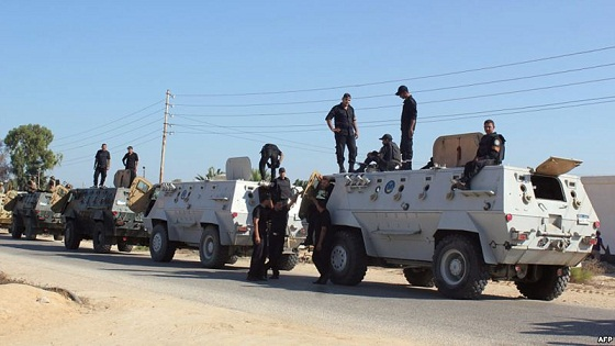 Egyptian security forces stand by their armoured personnel carriers ahead of a military operation in the northern Sinai Peninsula. (AFP PHOTO)