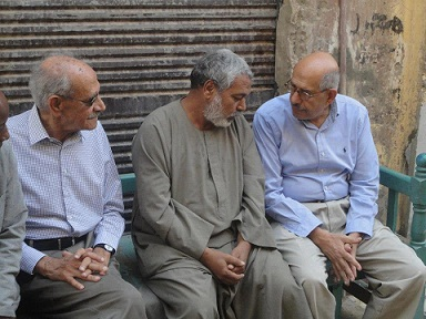 Mohamed ElBaradei (right) visits Aswan and talks to the father of Mohamed Mohsen, a young man who died in July during clashes near to the Ministry of Defense buildings in the Abbasseya district of Cairo. (DOSTOR PARTY FACEBOOK PAGE)
