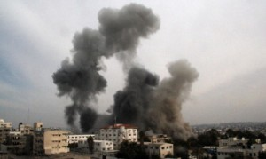 Smoke rises after an Israeli air strike onGaza City, on 21 November. (AFP PHOTO / EZZ AL-ZAANOUN)