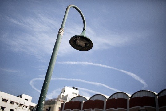 The white spirals of a patrolling Israeli drone are seen from the seafront in Gaza City. (AFP PHOTO / Marco Longari)