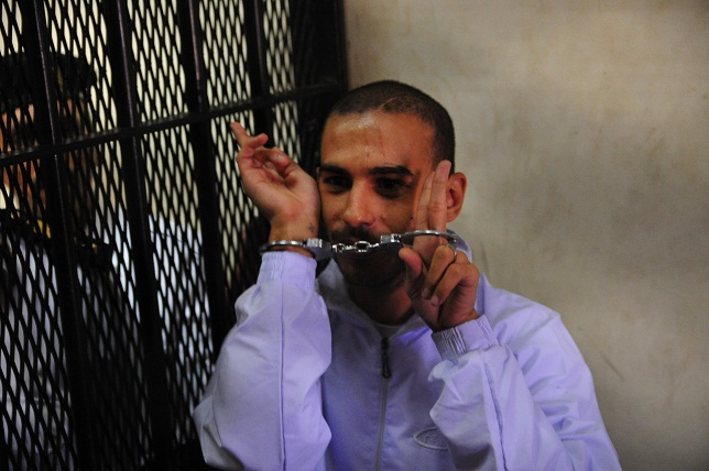 Alber Saber gestures to court while in custody. (DNE/ FILE PHOTO/ Hassan Ibrahim)
