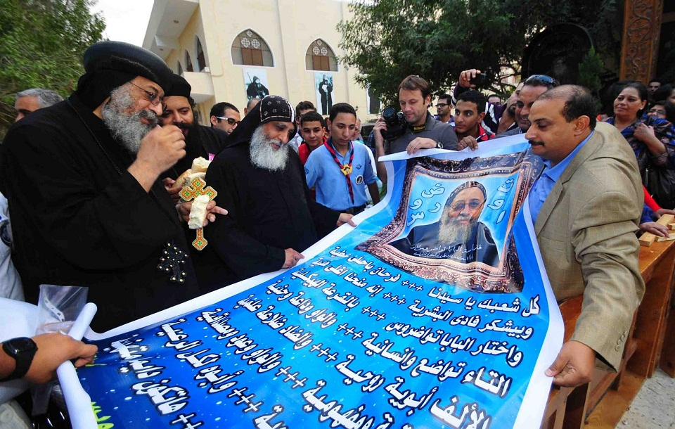 Worshippers present Bishop Tawadros with a new banner celebrating his ascension to the papacy Hassan Ibrahim
