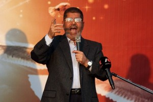 Mohamed Morsy addresses his supporters in front of the presidential palace in Cairo on Friday AFP PHOTO/STR