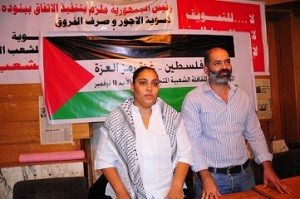 "Rasha Azab (left) and Mohamed Waked hold a press conference in Cairo announcing the formation of a ""political convoy"" to the Gaza Strip. (DNE / Hassan Ibrahim)"