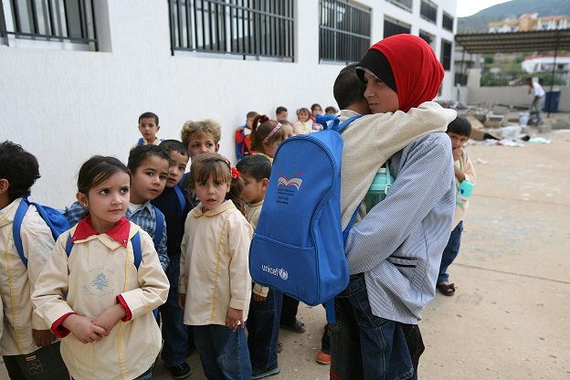 Children line up at a charity supported school in Cairo. (AFP PHOTO)