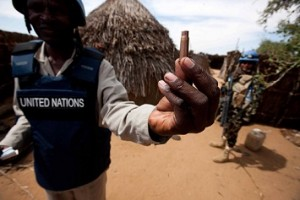A handout picture released by the United Nations-African Union Mission in Darfur shows a staff member holding a spent cartridge left behind by local militants. (AFP PHOTO / UNAMID / ALBERT GONZALEZ FARRAN)