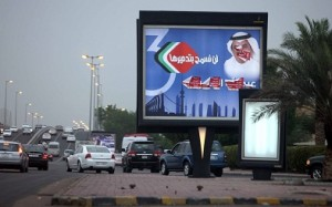 A defaced billboard for a candidate in the upcoming Kuwaiti parliamentary elections is seen at the side of a main road in Kuwait City. (AFP Photo / Yasser Al-Zayyat)