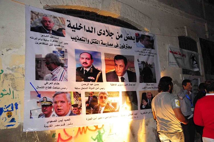 Murals and posters at a memorial rally for Essam Attam shows police and security force commanders who campaigners believe are responsible for torture and abuse of detainees Hassan Ibrahim