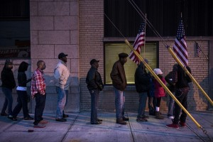 Voters wait in front of the Mt. Pleasant Library November 6, 2012 in Cleveland, Ohio. (AFP PHOTO / BRENDAN SMIALOWSKI)