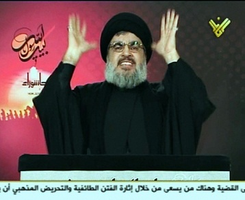 An image grab from Hezbollah's Al-Manar TV shows Hassan Nasrallah, the head of Lebanon's militant Shi'a Muslim movement Hezbollah, gesturing as he addresses thousands of Shiite Muslims gathered for Ashura. (AFP PHOTO / HO / AL-MANAR)