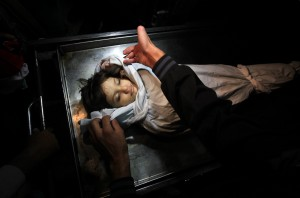 he body of Palestinian boy Abdel Rahman Majdi Naim lies in a hospital morgue after he was killed in a second Israeli strike on the building housing AFP's offices in Gaza city, according to Hamas health officials, on 21 November. (AFP PHOTO / MAHMUD HAMS)